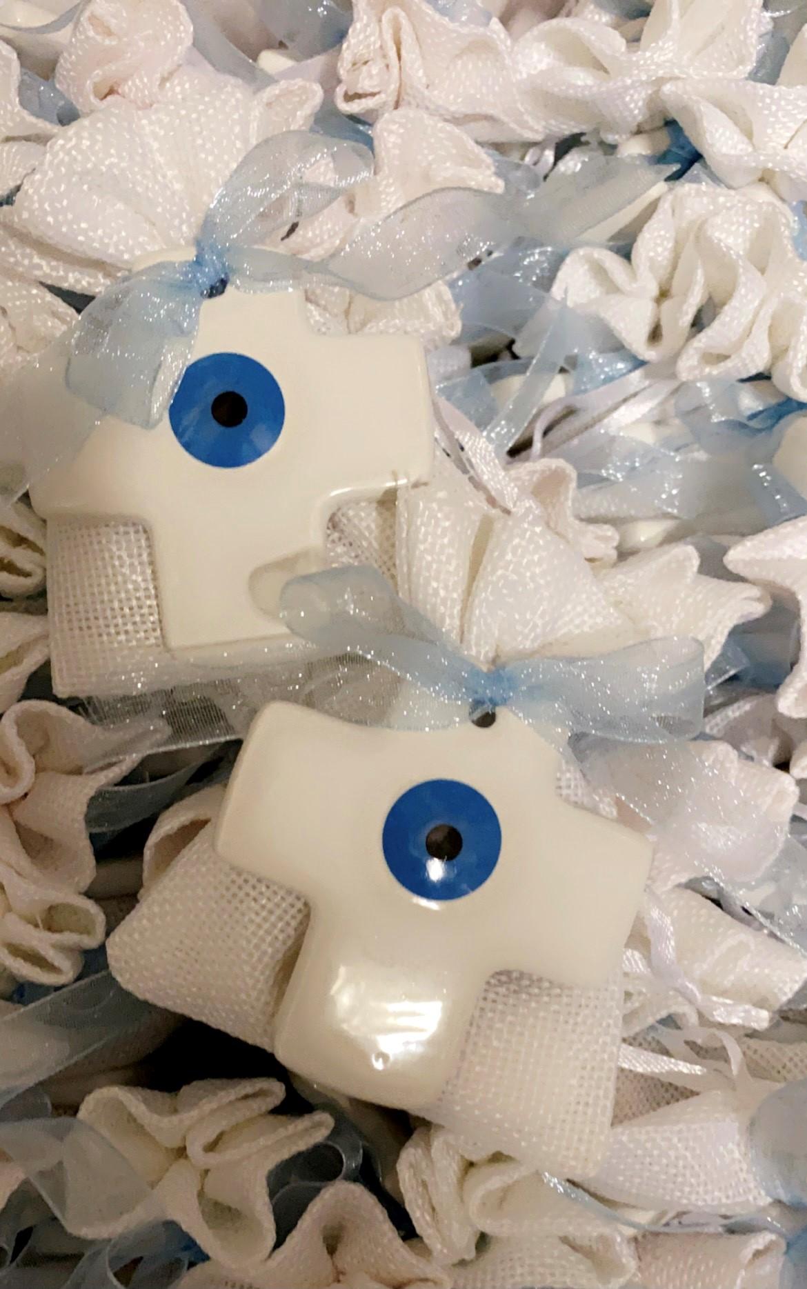 ceramic cross with eye on linen bag